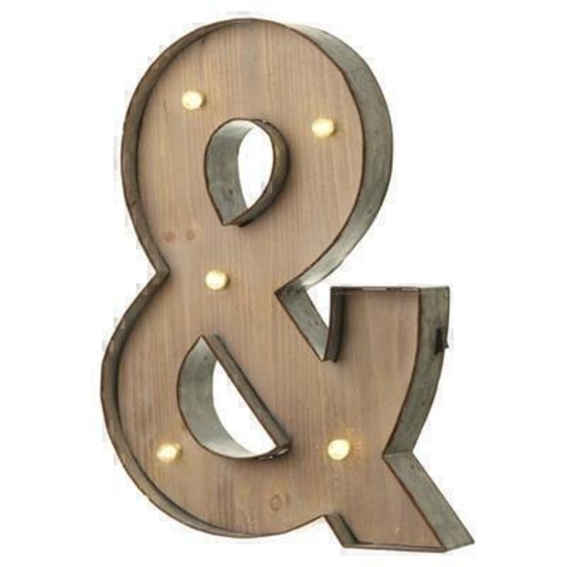 This and Sign With LED Lights by Heaven Sends could be paired with other letters to create a bespoke initial sign for a couple and or to be displayed on its own. Large in size this and sign has got LED lights and a switch on the side to turn it on. Made from wood and metal. Size: 32x5x41cm