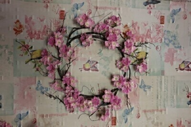 Artifical elegant wreath of pink blossom by Bloomsbury. Would look lovely hanging on a door or wall. For realistic artifical and silk flowers Bloomsbury is second to noneSize D 46cm.