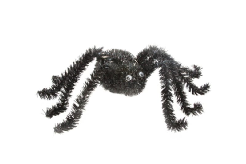 This black tinsel Halloween spider with googly eyes  can be put in any manner of positions around the home for the perfect Halloween fright. Perfect decoration for a Halloween party or to scare trick or treaters. Made by designer Gisela Graham.