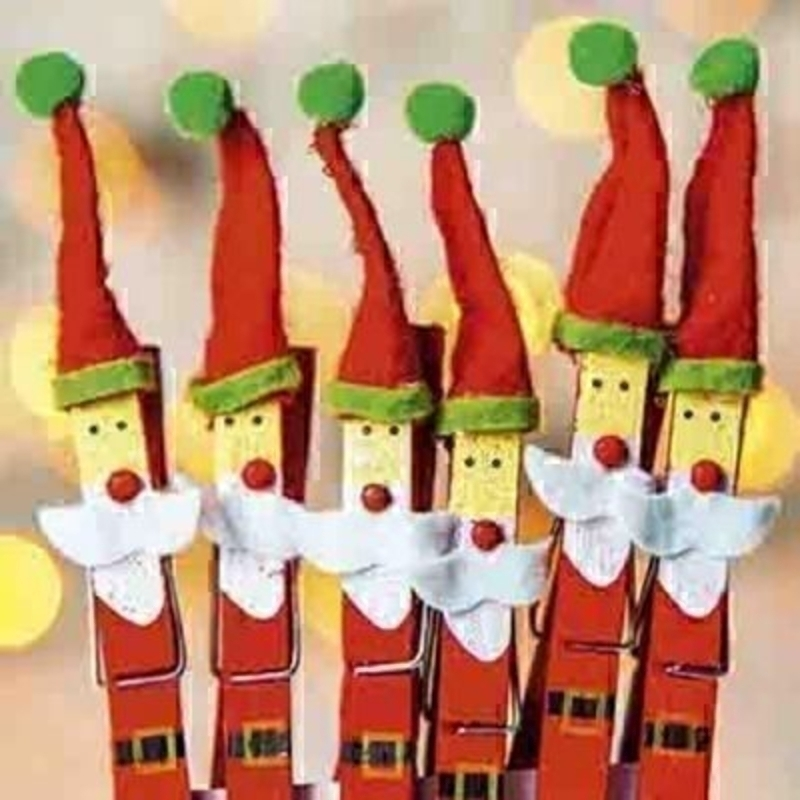 Box of 10 Charity Christmas Cards - Clothes peg Santas Comes with red envelopes. Photographic design of santas made from clothes pegs. In aid of Teenage Cancer Trust - 10% of price. 'Merry Christmas and a Happy New Year' on the inside. Christmas card siz