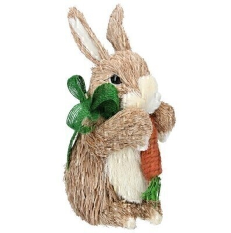 Cute bristle Easter bunny holding a carrot and wearing a lovely green bow. Ornament from designer Giesela Graham who designs unique Easter gifts and decorations. Would make a lovely Easter gift.
