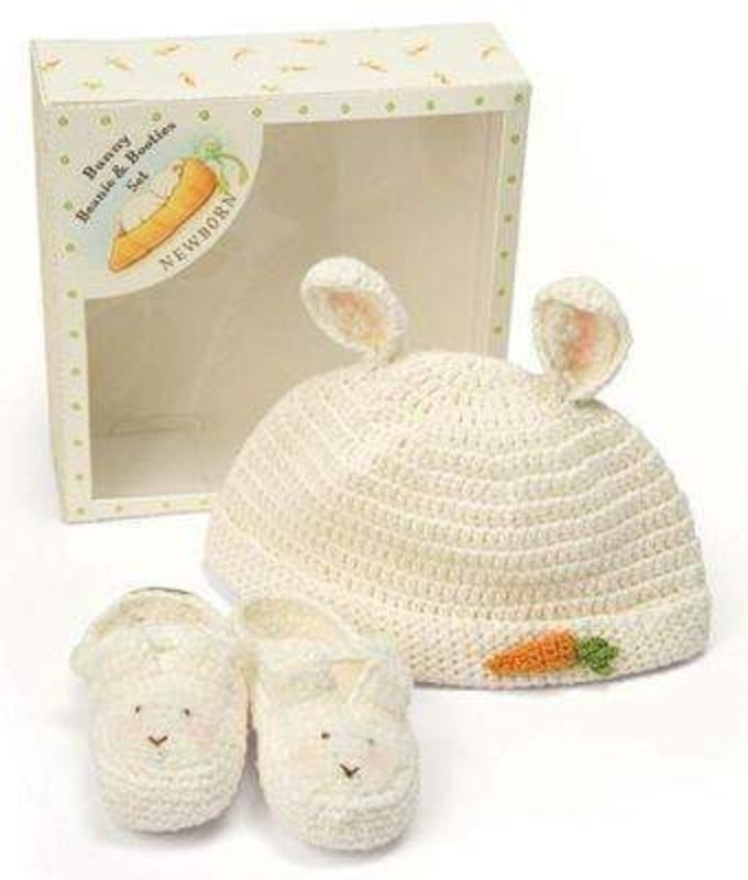 Bunny Rabbit Beanie and Bootie Set by Deva Designs. Part of the Bunnies by the Bay Range distributed by Deva Designs. Beautiful baby gift. Crocheted bunny hat and bootie set in newborn size. Comes gift boxed.