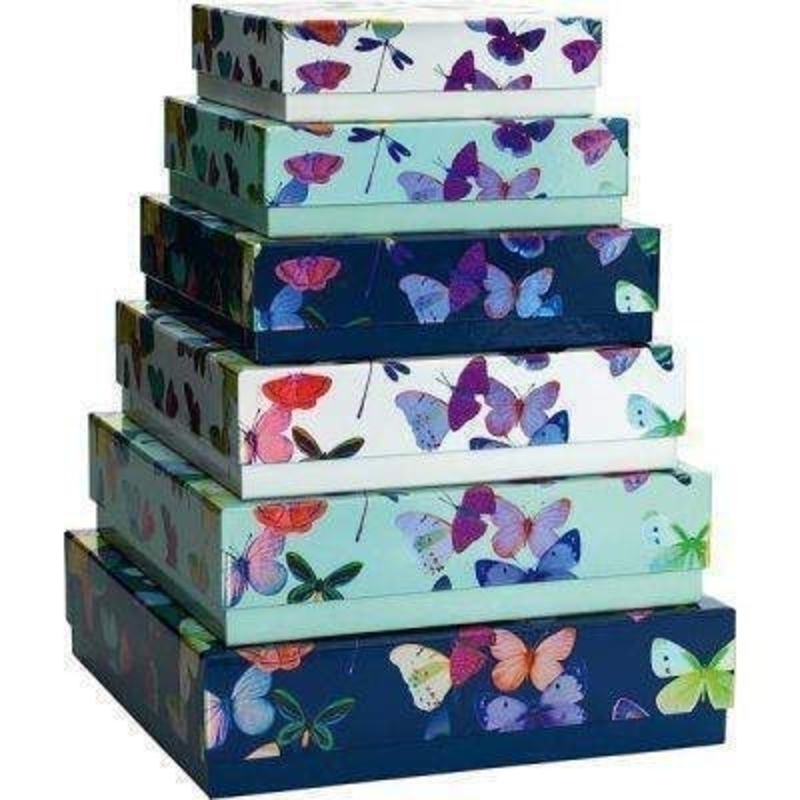 6 Part Butterfly Gift Box Set Mariposa by Stewo. This 6 Part Gift Box Stet is evereything you would expect from quality gift wrap supplier Stewo. The holographic butterfly design is on a gloss lamiate thick card. Bacground colour of boxes 2 dark blue -
