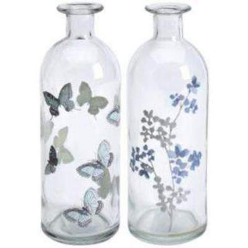 Choice of Butterfly or Flower Design Isabella Glass Bottle Vase by Transomnia. Delicate bottle shaped vase to hold flowers. A lovely glass vase that would look good in use or not. One bottle vase has a grey butterfly design on and the other has blue and grey flowers on. If a preference - please state Butterfly or Flowers when ordering. Size:  20 x 7 x 7cm