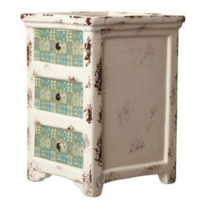 This Chest of Drawers Style Ceramic Pot by Heaven Sends would be a lovely addition to an inside or outside plant. In a distressed shabby chic style this cream ceramic pot has 3 featured drawers on the front of the pot in turquoise with an antique tile des