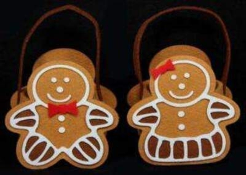 Choice of Boy or Girl Felt Gingerbread Bag by Gisela Graham. Gingerbread bag - would make great Christmas gift bag. 'piped icing' detail - man has a red bow-tie woman has a red hair bow. If preference please specify man or woman when ordering. Size 16x16x<br><br>