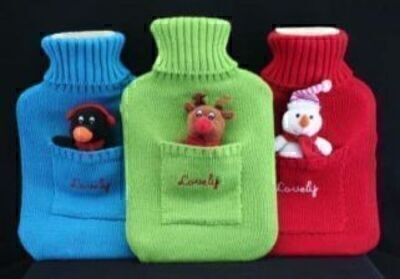 Choice of 3 Christmas hot water bottle by Gisela Graham. If preference please specify Red - Blue or Green when ordering. Size 33x21