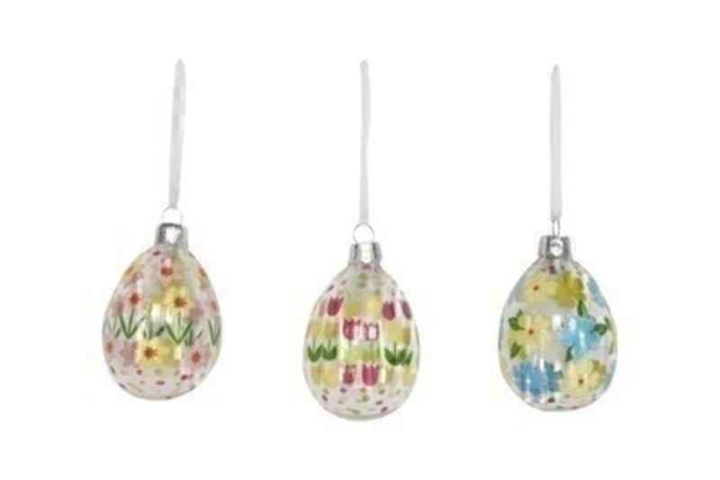 If you are looking for some Easter decorations for your Easter Tree then be sure not to miss these hand painted glass Easter Egg hanging decorations by designer Gisela Graham.  Choice of 3 available - daffodil or tulip or flower design (please specify when ordering which one you would like) Comes complete with ribbon to hang.