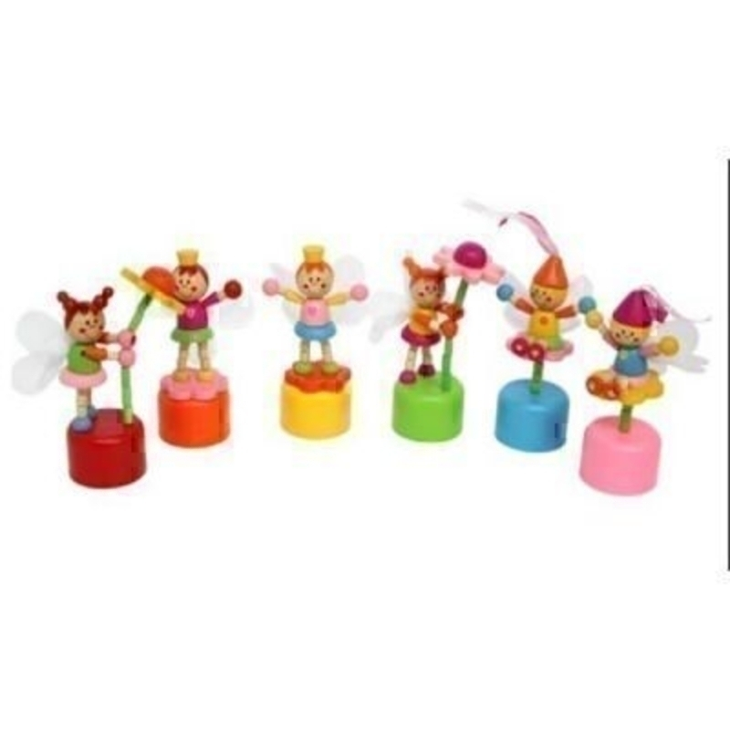 Choice of 6 Wooden Push Up Fairy Toy by Gisela Graham. Wooden Push up toys in 6 different fairy designs. Brightly coloured painted wood with net wings. If preference please specify choice by colour of the base - blue - green - orange - red - pink - or yello