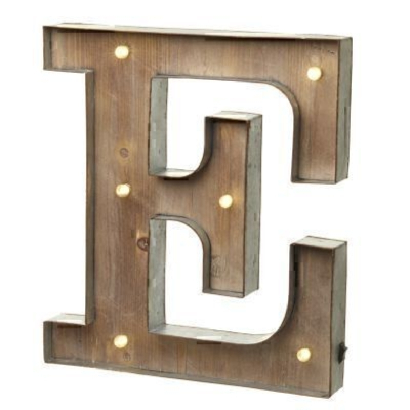 This E Sign With LED Lights by Heaven Sends could be paired with other letters to create a bespoke initial sign for a couple or to be displayed on its own. Large in size this S sign has got LED lights and a switch on the side to turn it on. Made from wood and metal. Size: 27x5x41cm