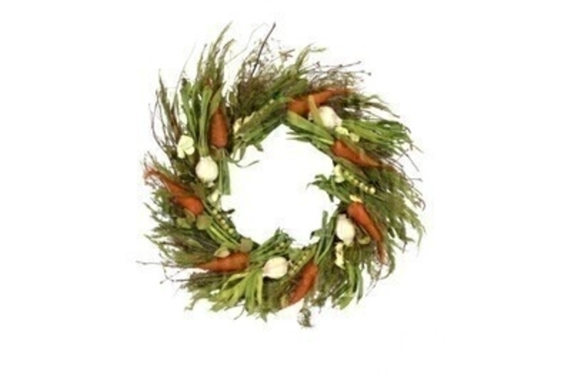 Easter green wreath with twigs and artifical vegetables including peas carrots onions.  This wreath design comes from designer Gisela Graham who makes unique Easter gifts.  Would make a lovely Easter gift.