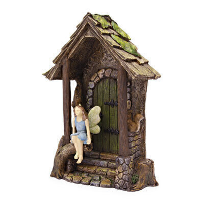 A cute Woodland Knoll miniature fairy with pale blue dress and wings that are brushed with pale green. This sweet fairy is sitting down on the steps to a hidden entrance and is joined by a small squirrel. The wooden hidden entrance doorway would be right at home in your miniature fairy garden either indoors our outdoors.