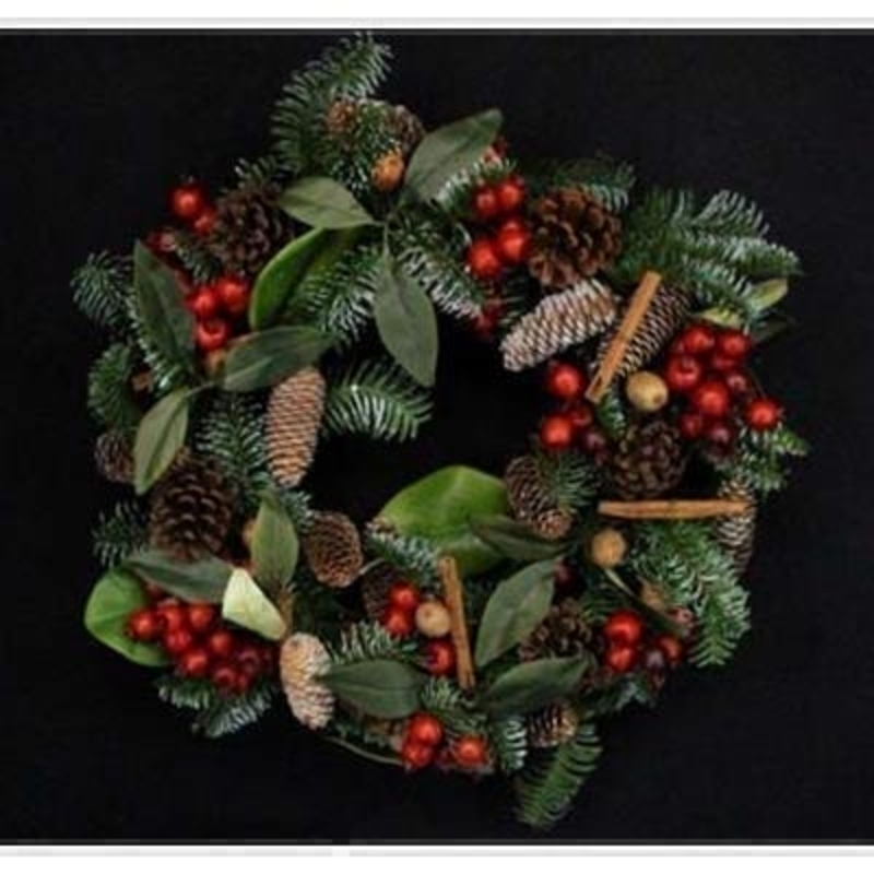 This traditional wreath brings a lovely festive feel to your home and can be used year after year. Decorated with pinecones red berries and cinnamon sticks. Matching garland available. Approx size (LxWxD) 55x55x15cm.