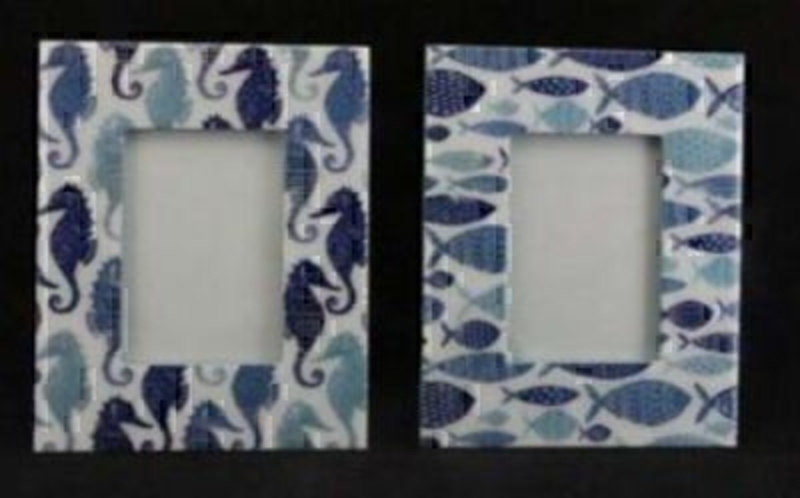 Fish or Seahorse photo frame by Gisela Graham. Blue and white in colour and made with high Gloss Wooden Rectangle Picture Frame. If preference please specify Fish or seahorse when ordering. For photo size 5