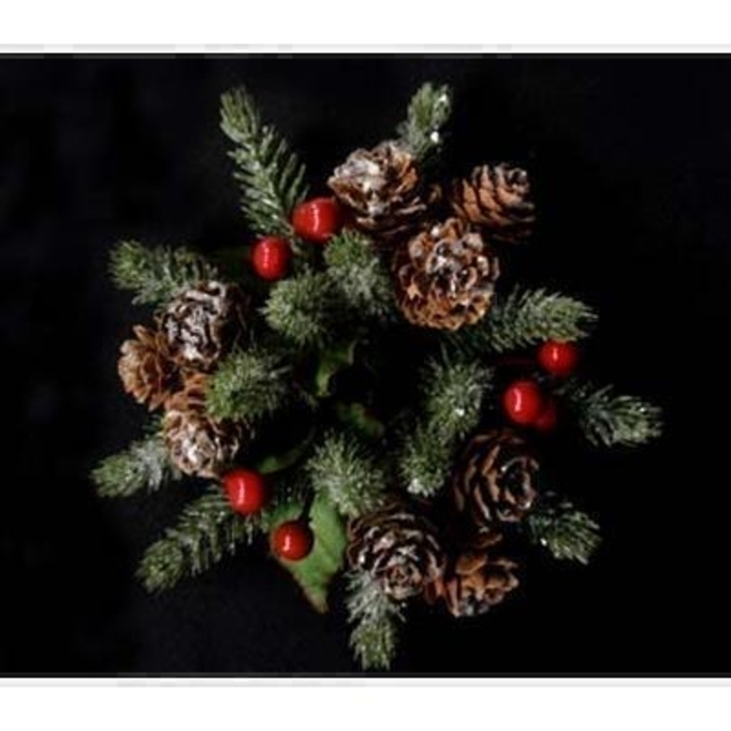 A wonderful addition to your dinner table this Christmas. Decorated red berries and pine cones and dusted with a frosting this traditional candle ring is timeless in style. Also available in large size. Approx size 4x11.5x11.5cm