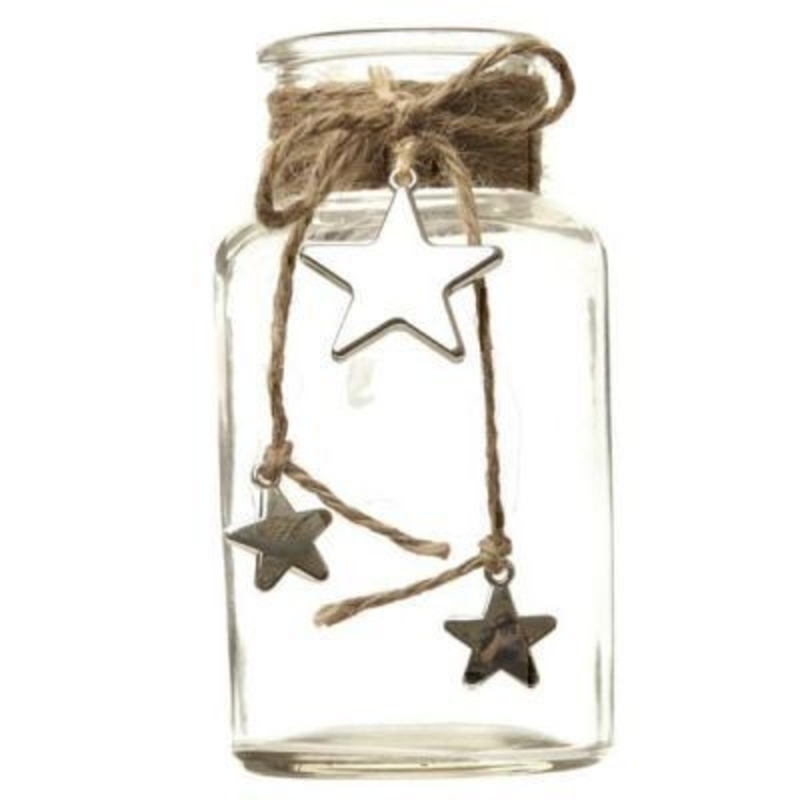 This Glass Jar with Hanging Stars by Heaven Sends is a lovely gift and could be used for a lot of purposes. This small glass jar features 3 metal stars hanging from twine around the neck of the jar. It could be used as a vase a pen pot on a desk or a toot