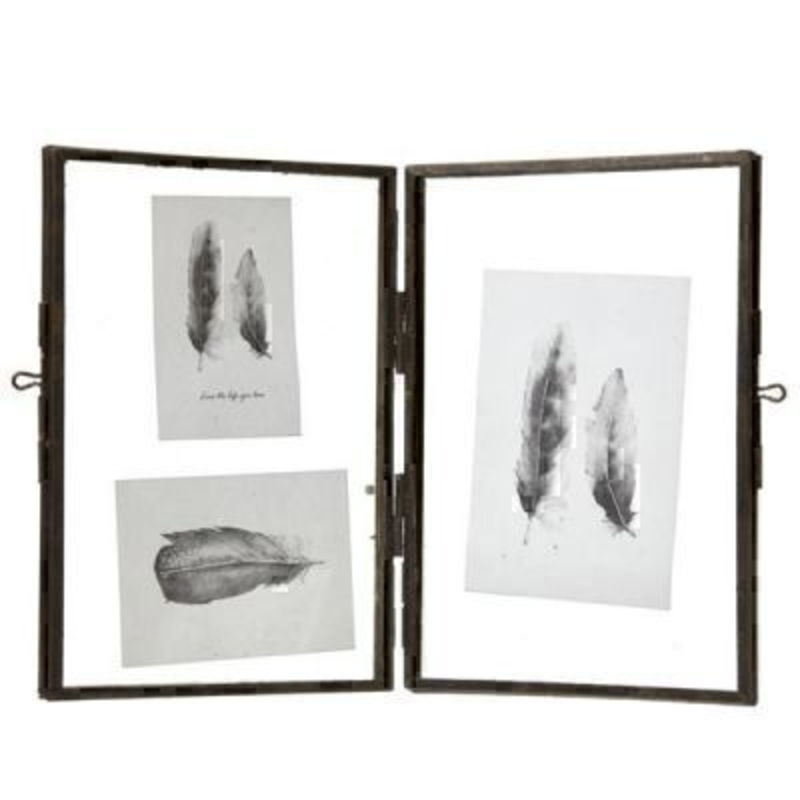 This Hinged Iron Glass Photo Frame by Heaven Sends is a lovely gift for anyone. The frame is simply an iron style frame with a hinge in the middle and the photos float in between 2 sheets of glass. Each side has a hanging loop so this iron and glass frame