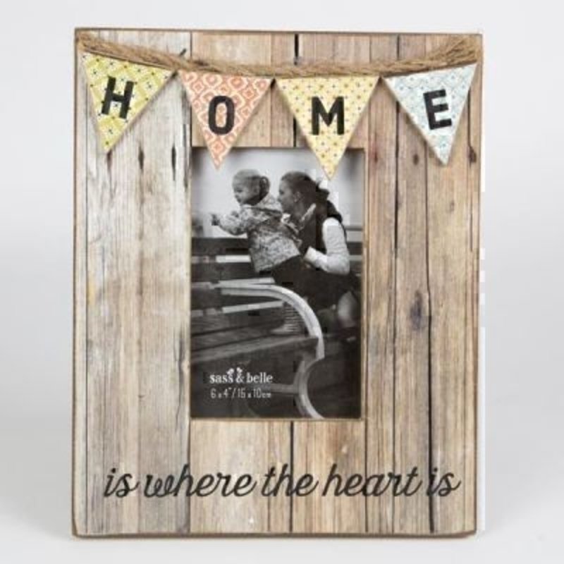 Home Bunting Photo Frame by Sass and Belle. This rustic distressed look wooden picture frame had really beautiful bunting detailing with 'Home is where the heart is caption' Has a stand at the back so that it can be placed on a flat surface. Size 26x20