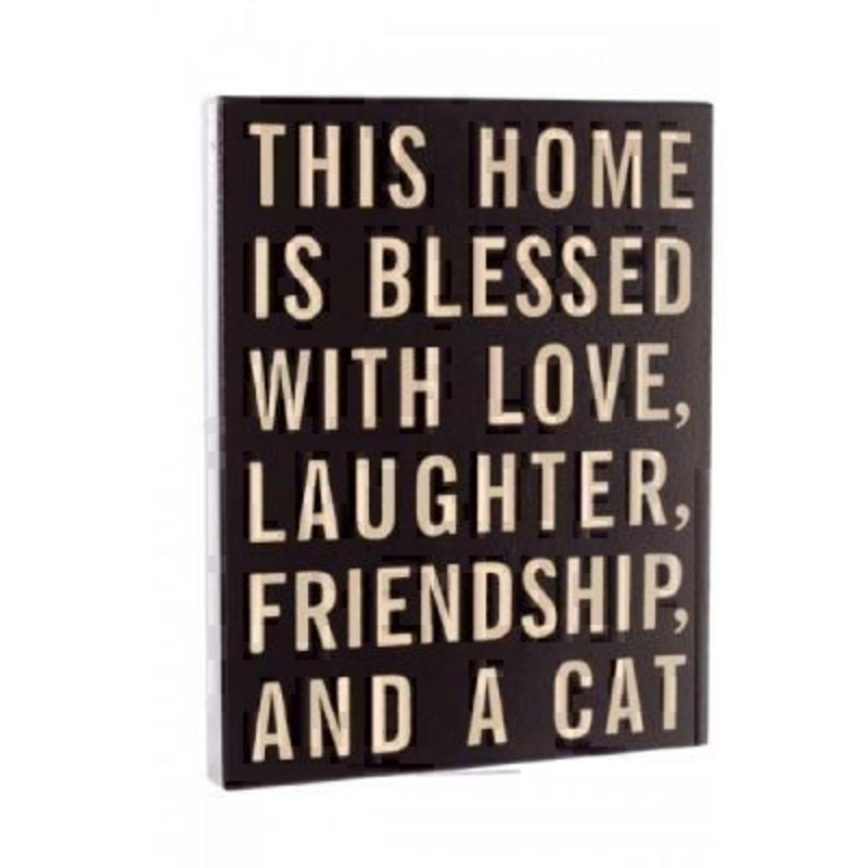 Home is Blessed with A Cat Sign by Heaven Sends. Black sign with cream writing with caption 'This home is blessed with love - laughter - friendship - and a cat' Size 30x24x2.5cm