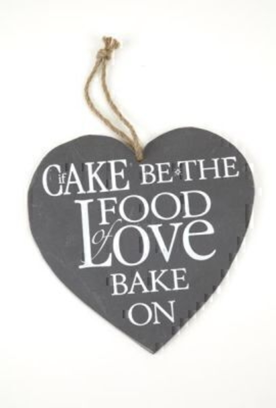 If Cake Be The Food of Love Slate Heart by Heaven Sends. Heart shaped slate with the caption 'If cake be the food of love bake on. Rope hanger. Size 21x22cm.
