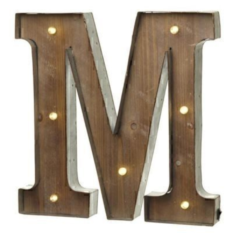 This M Sign With LED Lights by Heaven Sends could be paired with other letters to create a bespoke initial sign for a couple and or to be displayed on its own. Large in size this M sign has got LED lights and a switch on the side to turn it on. Made from wood and metal. Size: 41x5x41cm