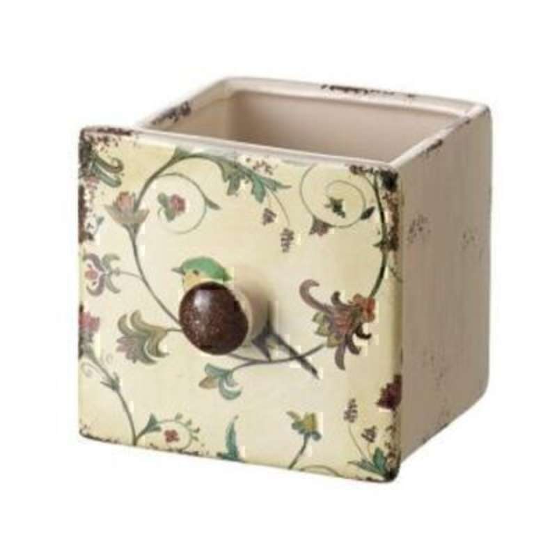 This Medium Sized Vintage Ceramic Pot in a Drawer Style by Heaven Sends is a quirky choice of pot for your home. In the style of a drawer it features a drawer knob and a bird and leaf pattern on the front. This vintage style pot in the shape of a drawer i