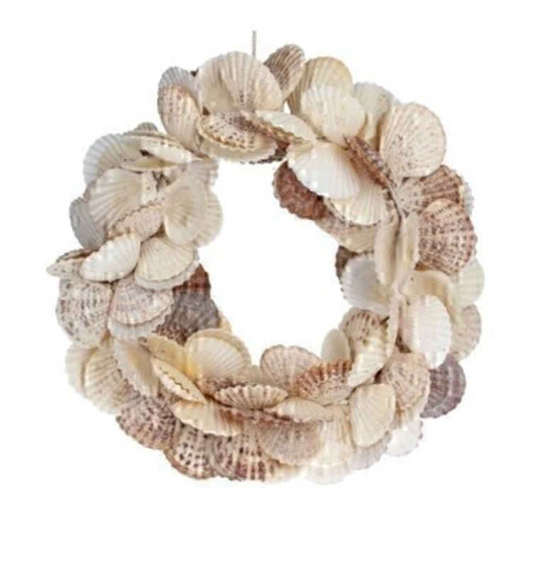 Decorative Shell Door Wreath made from Scallop Shells by designer Gisela Graham. This seashell hanging door wreath is a statement piece all doors deserve. Would make an ideal gift for someone special or as a treat to yourself to hang on your front door or internal door or wall. Also available in different shell designs.