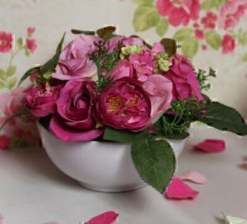 Cerise Pink Artificial Rose Flower Arrangement in Bowl by Bloomsbury. Ceramic Bowl. Can also be called silk flowers the quality of these artificial flowers by Bloomsbury is second to none. For Realistic fake or silk flowers Bloomsbury are the perfect c