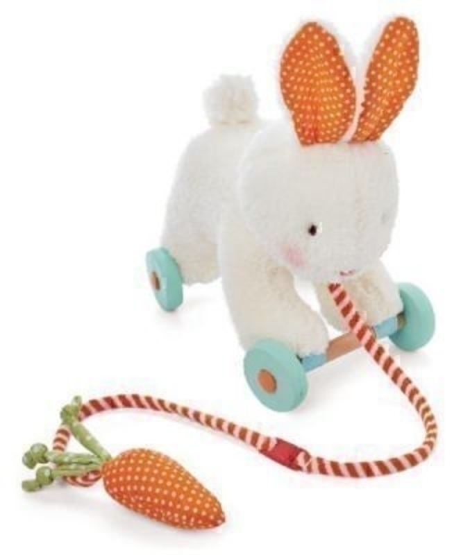 Pull Along Bud Bunny Rabbit by Deva Designs. Part of the Bunnies by the Bay Range distributed by Deva Designs. Wheelie bunny rabbit pull along - plush bunny with embroidered face and bushing tail. The wooden wheels are detachable making him easy to clean