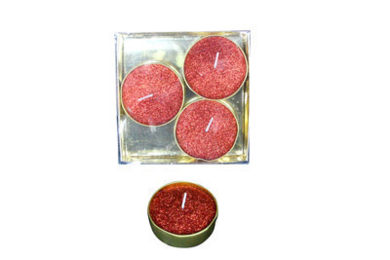 Light up your home with this set of 4 large wax tea light candles in Glittery Red by designer Gisela Graham.