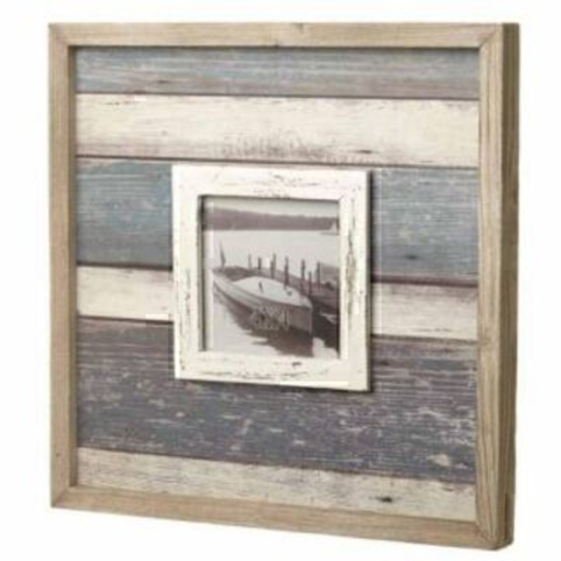 This Square Striped Blue and White Wooden Photo Frame by Heaven Sends is perfect for a seaside theme. The striped photo frame has a natural wood outside frame and sitting inside is blue and white stained wood with a smaller frame to house a 4 x 4 inch pho