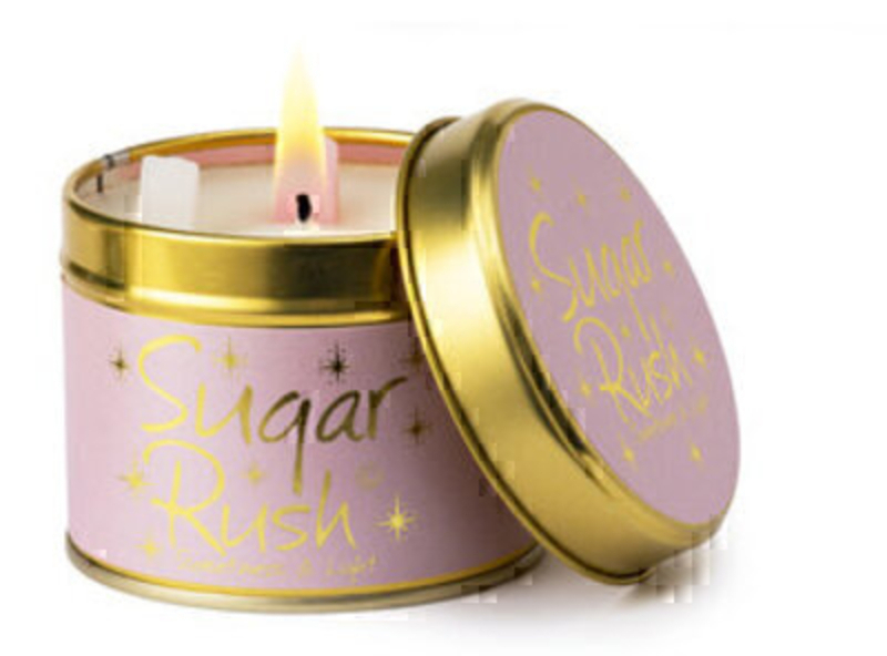 Sugar Rush Scented Candle in Tin by Lily Flame Let Lily Flame transport you to a different place. Sugar Rush – Sweetness and Light! Sweet and sensual blending an amber base floral body and powdery top notes. Burn Time 35 hours