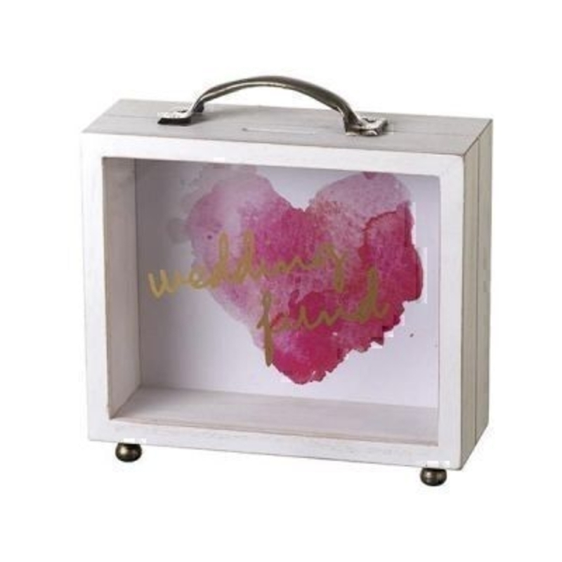 This Wedding Fund See Through Money Box by Heaven Sends is perfect for anyone saving for their wedding. In the shape of a suitcase with a handle on the top it features a pink heart on the background and the front is see through with the words Wedding Fund