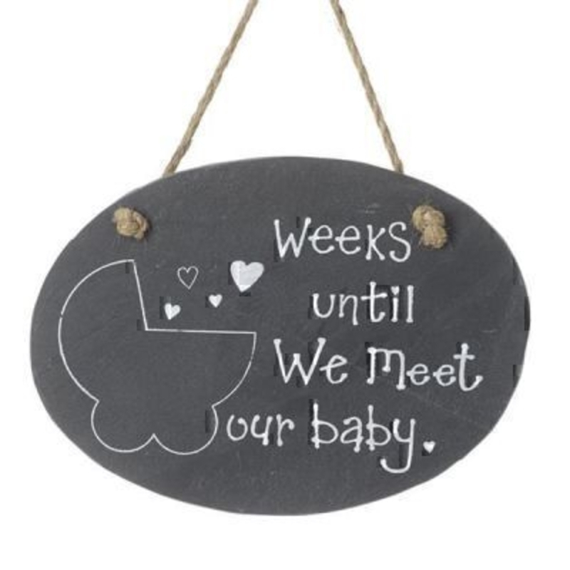 Weeks Countdown Baby by Heaven Sends. Slate Chalk board sign for you count days until a babys due date. Excellent baby shower gift for expectant parents. A picture of a pram on the front is where the weeks are written and the words ''Weeks until we meet our baby'' Size 19x13cm