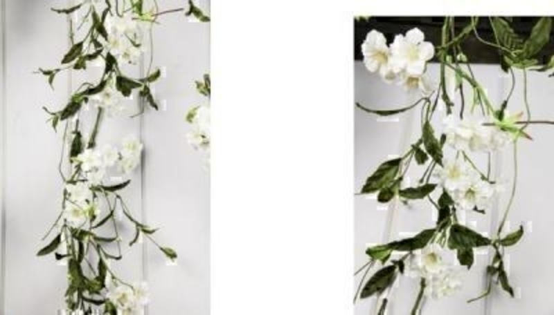 Artificial Cherry Blossom Garland by Bloomsberry.This stunning silk Cherry Blossom garland looks as realistic as possible for artificial flowers and the lifelike movement mimics that of their natural counterpart. For realistic fake and silk flowers Blooms
