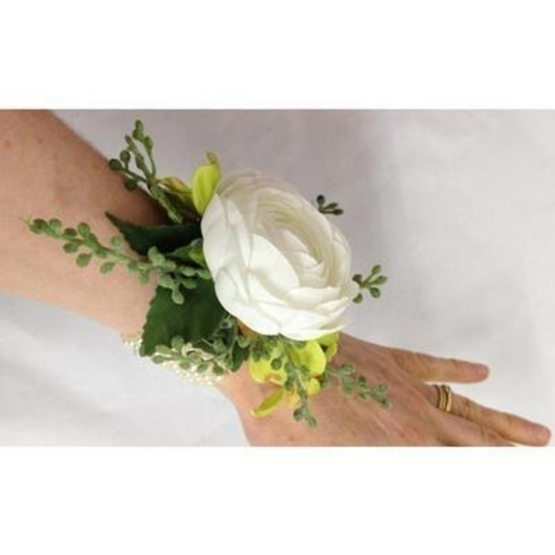 This artificial flower wrist corsage if perfect for Prom Parties or Festivals. The flowers are set onto a pearl bracelet.