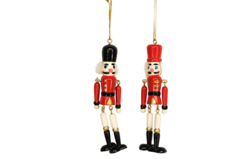 Decorative Wooden Christmas Nutcraker Christmas Tree hanging decoration by Gisela Graham would look lovely on your tree this Christmas. Choice of 2 - If you have a preference please specify when ordering. This fesive jointed nutcracker ornament by Gisela Graham will delight for years to come. It will compliment any Christmas Tree and will bring Christmas cheer to children at Christmas time year after year. Remember Booker Flowers and Gifts for Gisela Graham Christmas Decorations. Please note this is not a set of 2 - there is a choice of 2 different designs.