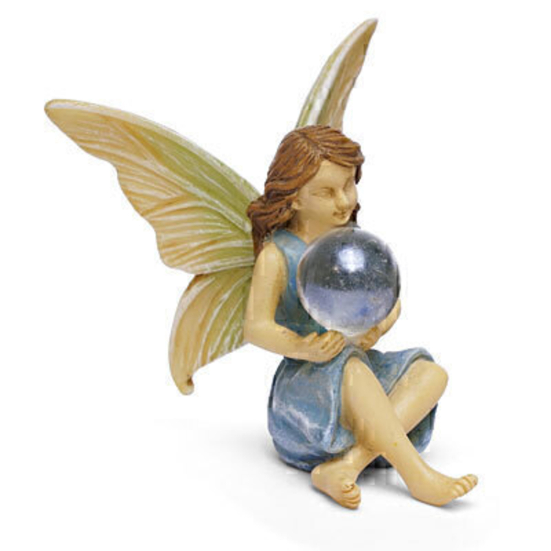 A classic Woodland Knoll miniature fairy with pale blue dress and wings that are brushed with pale blue. This sweet fairy is sitting down and holding a little glass orb. The fairy is  2.5 high x 2.5 inch wide. This would be right at home in your miniature fairy garden either indoors our outdoors.