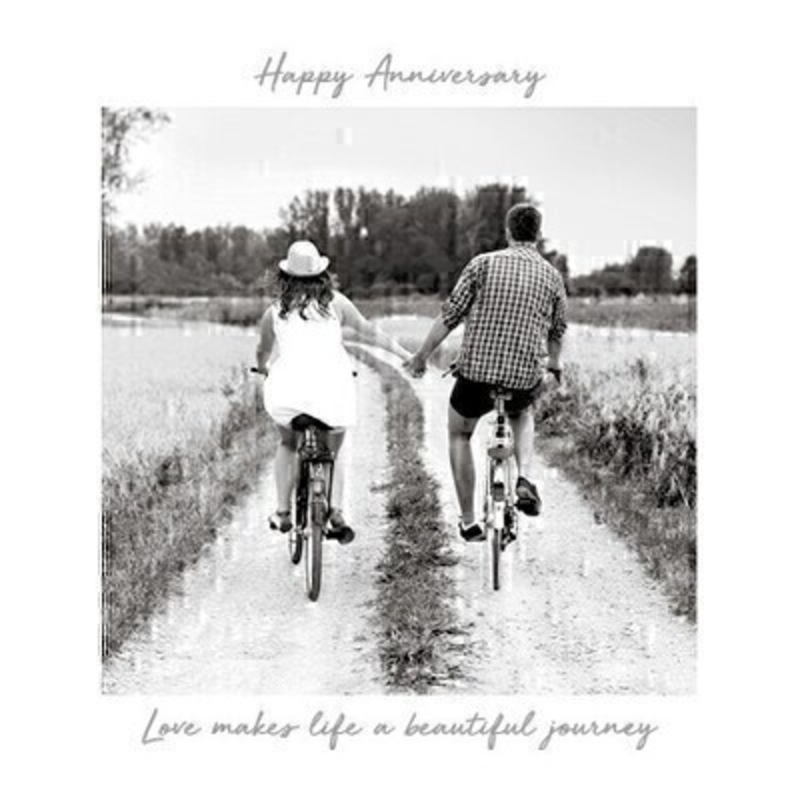 This Anniversary greetings card called Happy Anniversary Bikes features a couple riding bikes down a lane and holding hands with the inspirational message Love Makes Life a Beautiful Journey written on the front.  This card is perfect to send to someone celebrating an Anniversary and has been left blank inside so you can write your own message. It comes complete with a red envelope and is a lovely card from the Art Group.