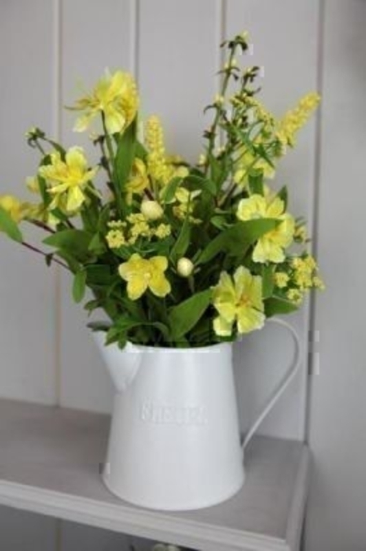 Jug of Yellow Artificial Meadow Flowers by Bloomsbury. Tin Jug with 'Flowers' written on. Can also be called silk flowers the quality of these artificial flowers by Bloomsbury is second to none. For Realistic fake or silk flowers Bloomsbury are the perf