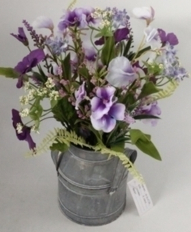 Lilac artificial meadow flowers by Bloomsbury. These stunning silk flowers come pre arranged in this lovely zinc churn and look hand picked from a meadow especially for you. For realistic artifical and silk flowers Bloomsbury is second to none.