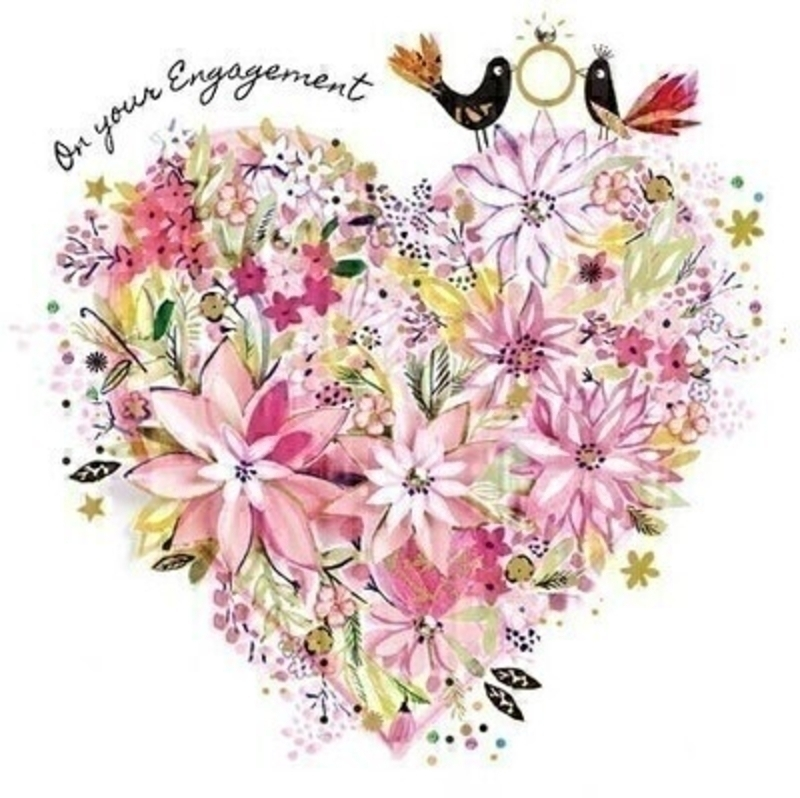 This Engagement greetings card from Paper Rose is decorated with two love birds holding an engagment ring sitting on a heart made from pink flowers and ON YOUR ENGAGEMENT written on the front. The card is perfect to send to someone celebrating an Engagement and it has Wishing You All The Happiness In The World written on the inside. Comes complete with a pink envelope.