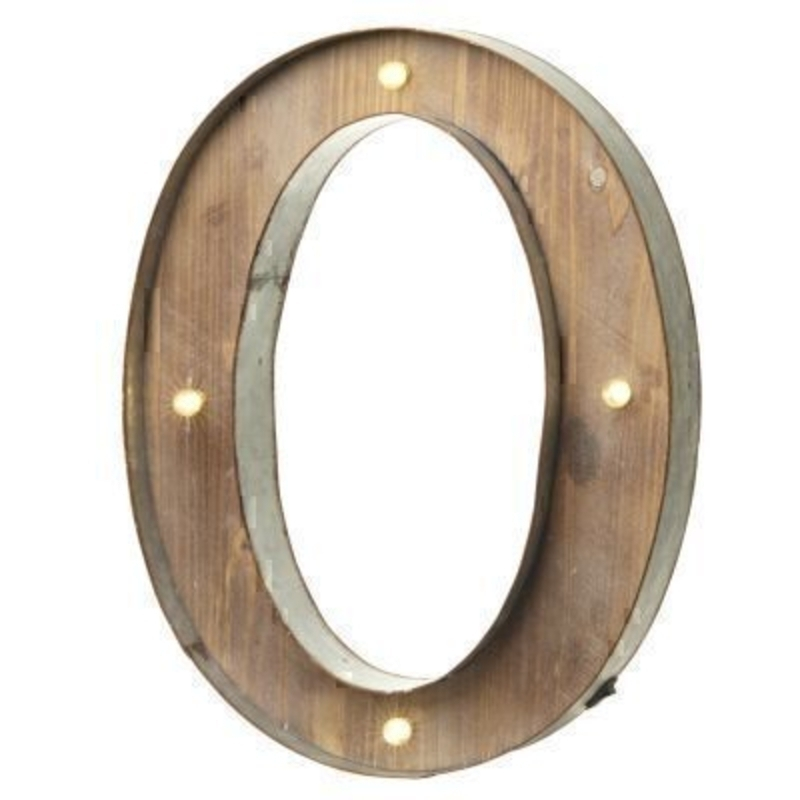 This O Sign With LED Lights by Heaven Sends could be paired with other letters to create a bespoke initial sign for a couple or to be displayed on its own. Large in size this M sign has got LED lights and a switch on the side to turn it on. Made from wood and metal. Size: 41x5x41cm