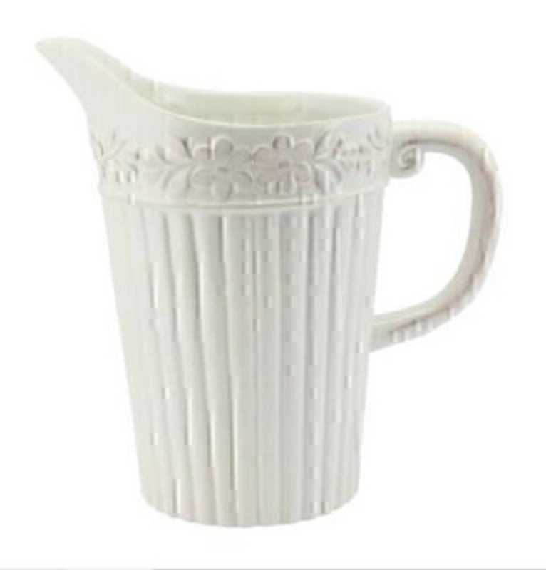 Large white rustic ribbed ceramic pitcher jug with flower design by designer Gisela Graham.  This item would look great on display in your kitchen or would make an ideal new home gift.  Size (LxWxD) 23cm x 22cm x 14cm.