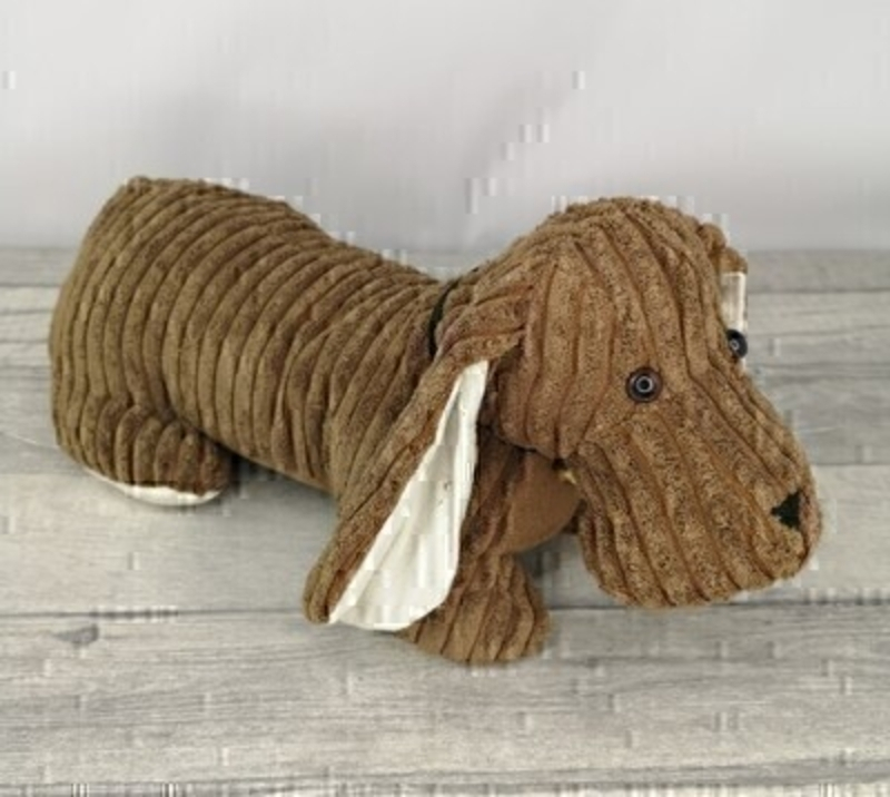 Sausage Dog Doorstop. Perfect for any home. No more slamming doors thanks to this functional doorstop in the shape of a cute dog. They are made from material designed not scratch doors and floors. Functional and decorative piece (Not a toy)