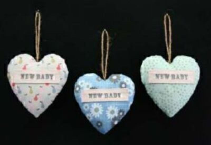 Part of the Gisela Graham vintage baby range, your choice of 3 fabric 'New baby' Heart Decorations. A great add on gift for a boy or girl baby. If preference please specify Blue, Green or Pears when ordering. Size 9cm.