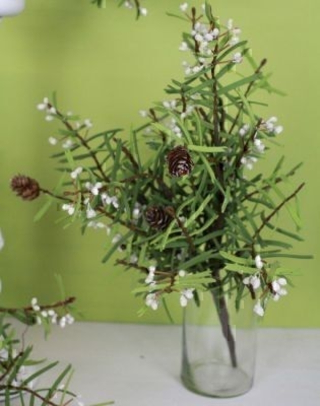 A stunning artificial flower arrangement designed for the Christmas period by Bloomsbury Flowers. The arrangement boast a gorgeous array of white berries, cones and Christmas foliage. This is a wonderful addition to the Christmas collection.