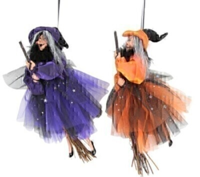 Spook your Halloween guests with these purple and orange witches on broomsticks by designer Gisela Graham. Great for Halloween parties.  Choice of 2 colours available - If you have a preference of colour please specify when ordering.  Purple Witch and Orange Witch can be hung on your wall or in your window to make a great addition to your halloween decorations.