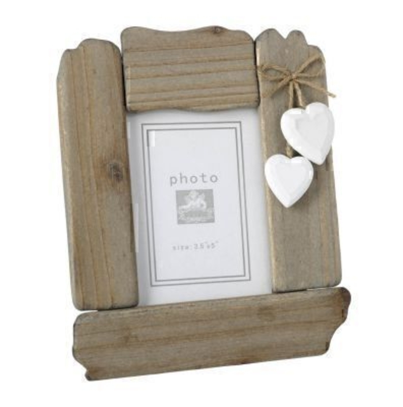 This is a lovely Wooden Frame with Hearts by Heaven Sends. The frame is in a driftwood frame style. The white hearts hang from a piece of twine attached to the top corner of the frame. Suitable for 3.5 x 5 inch photos. Size: 17x1.5x20.5cm