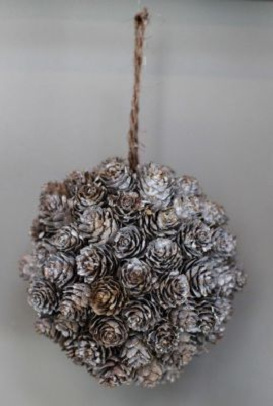 Hanging Ball Of Acorns With Snow Dust Covering